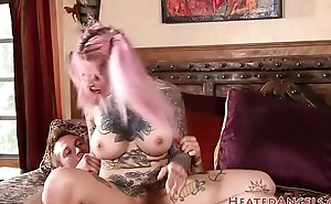 Tattooed goth babe riding cock after oral