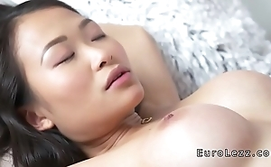 Petite Asian busty lesbian has oral sex